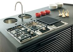 The Wolf wok cooktop integrates with the gas cooktop and electric grill.
