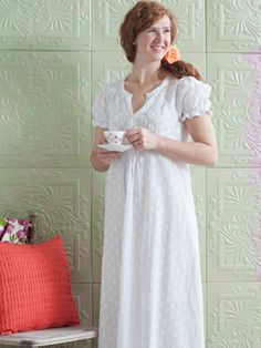 The 'Jardin' nighty's free, feminine feel integrates a delicately embroidered bodice, crochet trimmed puff sleeves and smocking detail below the empire waist.  http://www.aprilcornell.com/product/Jardin-Ladies-Nighty-NTAA5252W-White/nightwear
