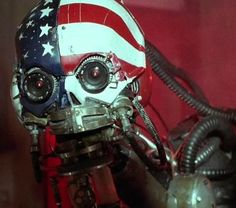 M.A.R.K. 13 from Hardware (1990). This un-killable murder-bot stalks post-apocalyptic deserts and cities, making Hardware one of the only killer cyborg/wasteland films ever made.
