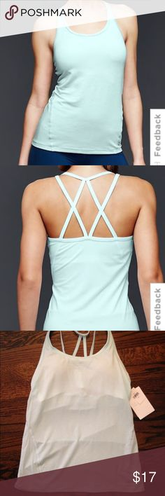 NWT GapFit Breathe Strappy Shelf tank Size Small Brand new! Has built in shelf bra, removable cups, and slimming seams. Offers accepted! GAP Tops Tank Tops