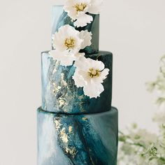 Teal, charcoal gray, and gold leaf combine in a dark romance palette reminiscent of the Gilded Age with marbled details and a sparkling wedding dress!