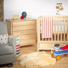 Gustaf Crib styled by Giggle with our whale push toy and whale mobile.