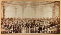 A LARGE PERIOD MOUNTED PHOTO OF THE 1903 IMPERIAL RUSSIAN COSTUME BALL. The large albumen print mounted on cardstock and depicting in the immediate front center Tsar Nicholas II and his wife Alexandra Feodorovna, together with their guests dressed in 17th century costume.