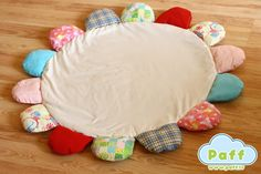 Baby play mat, cotton fabric, round, flower shape, educative rustling details.