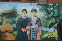 Walnut Grove Awesome mural Laura. This snippet of the mural shows Laura Ingalls Wilder as a teacher next to a Hmong woman. To the left is the log bridge spanning Plum Creek, where the Ingalls family lived in a dug out.
