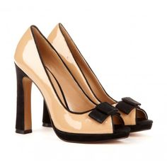 Classic peep toe pump with flared heel and bow detail.