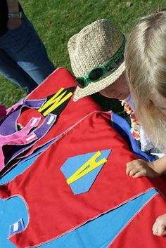 Superhero party: Capes for each child with personalized initial. Obstacle course.
