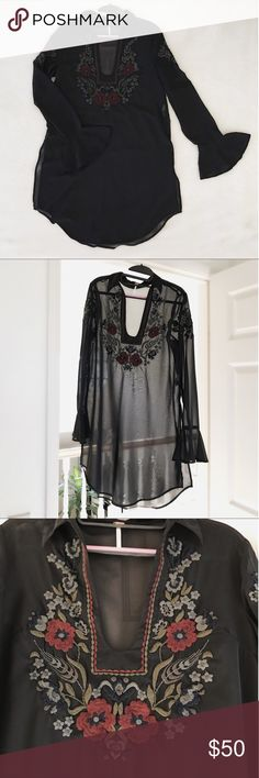 Sheer black embroidered tunic from Free People This is a beautiful sheer tunic from Free People with detailed floral embroidery on the chest and upper arms. I've worn it with a black slip dress under it and thigh high boots and wide brimmed fedora. A perfect fall look! Free People Tops Tunics