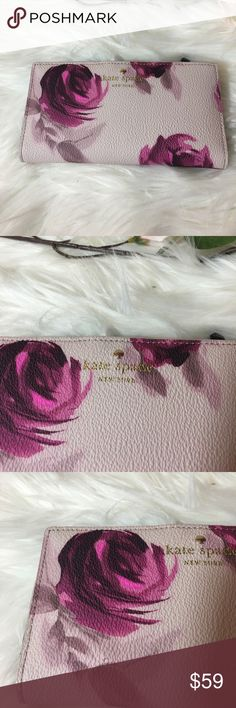 """Kate Spade Stacy Wallet Roses Brand new Kate Spade Stacy Wallet Hawthorne Lane Roses in Pale Pink background.Exquisite painterly flowers add vintage charm to a streamlined wallet that keeps your essentials smartly organized. Snap-tab closure. Exterior zip pocket. Interior wall and currency pockets; ID window; 12 card slots. Signature jacquard lining. PVC with leather trim.7""""W x 3 ½""""H x 1""""D. kate spade Bags Wallets"""