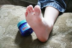 Rub Vicks on the bottom of your feet then put on socks before bed to ease a bad cough.