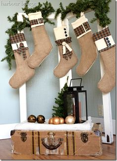 Burlap and Flannel Christmas Stockings - I like the use of chicken wire and vintage suitcase to showcase