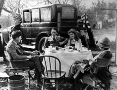 April 1921 Mary Pickford who was a co-founder of United Artists is with her brother Jack at lunch, during the making of 'Through the Back Door' which he directed.