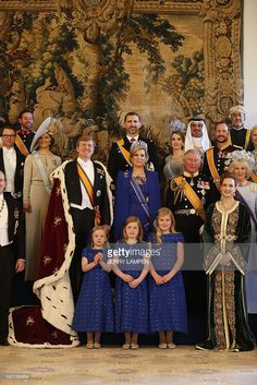 King Willem-Alexander of the Netherlands (C, L) and his wife Queen Maxima (C, R) pose for a photo with their childre, members of the royal household, heads of state and government and special guests at the Royal Palace in Amsterdam on April 30, 2013. Crown princely couple of Norway attended.