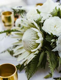 White protea centerpiece   White wedding centerpiece ideas