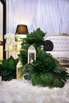 The pelamin for Nadlin's nikah ceremony. #wedding #green #black #white #foliage #velvetdrapes #tropical