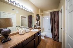 Get an inside look at the beautiful apartment homes and community at Griffis SoCo Austin in Austin, TX. Apartment Locator, Austin Apartment, New Cabinet, Austin Tx, Apartments, New Homes, Bathroom, Modern, Furniture