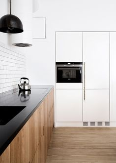 oak, white and black kitchen