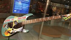 """KIRK HAMMETT MONSTER GUITAR COLLECTION: While rushing through the San Francisco airport, we stopped to view an amazing museum exhibit of monster memorabilia in the Virgin American Airline terminal. Some very cool custom guitars! Only thing missing was my """"FRANKENSTEIN"""" Lunchbox-A-Lele! A must see if you're traveling through SF during the Halloween season! HORRIBLY AWESOME!"""