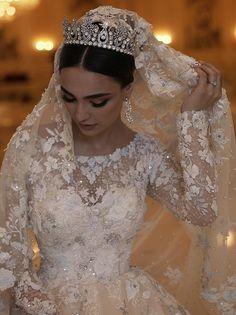 A beautiful bride wearing a stunning ballgown with long sleeves adorned with floral lace. Stunning Wedding Dresses, Dream Wedding Dresses, Bridal Dresses, Braut Make-up, Wedding Veils, Wedding Looks, Beautiful Bride, Marie, Wedding Inspiration