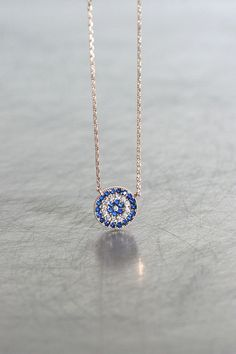 Rose Gold Sapphire Blue Disc Evil Eye Necklace Sterling Silver from kellinsilver.com