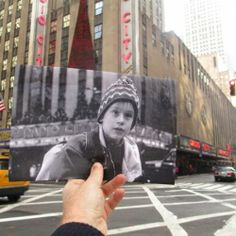 Photos from Popular Movie Scenes Held Up in Front of Real World Location by Christopher Moloney.