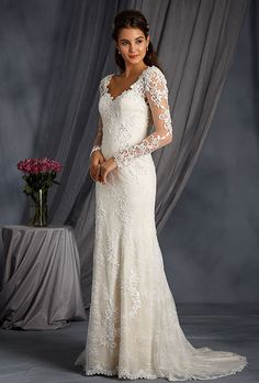 Brides: Alfred Angelo Collection. Timeless gown of net and allover lace layered over charmeuse featuring a dramatic low sheer back neckline, full length sheer lace sleeves and a soft fit-and-flare silhouette. Sweetheart neckline and sleeves are delicately beaded with crystal throughout and the softly flared skirt finishes with a chapel length train trimmed in matching appliqué. Also available with straps as style 2547.