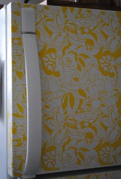 DIY Designer Fridge Tutorial : use printed contact paper (aka adhesive shelf liner paper) to give a boring white fridge a designer look.