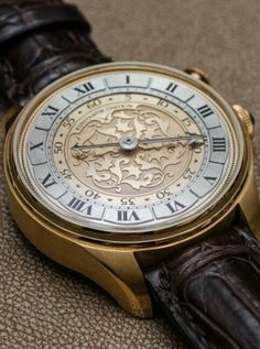 """Konstantin Chaykin Genius Temporis Single Hand Watch With A Twist - This is Russian watchmaker Konstantin Chaykin's latest timepiece, and they call it the Genius Temporis, which roughly translates from Latin to """"the spirit of our time."""" That, however, doesn't particularly explain the functionality of this 16th century-style timepiece. What you have is the simple elegance of a single-handed watch with the ability to also know the minutes (on demand) when the wearer chooses. Single-handed…"""