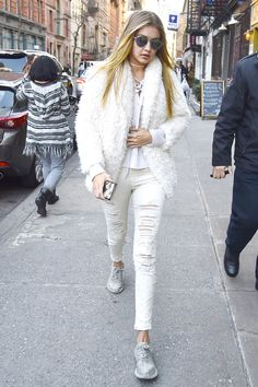 January 6, 2016 Hadid put her own spin on winter whites with distressed denim, a fur jacket and matching choker.