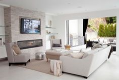 Linear Fireplace Living Room Contemporary with Glass Shelves Indoor Outdoor Monochromatic Moroccan Pouf Neutral