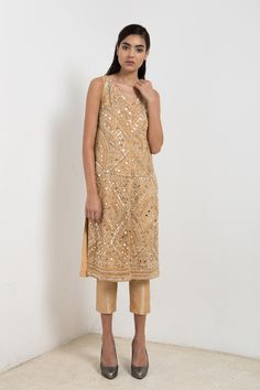Gold sleeveless jacket with mirror embroidery and pants