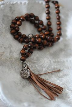 I'm seeing a lot of leather tassels with knotted beads. You could use something else, like fabric ribbon or sari silk yarn, as well. Diy Jewelry, Beaded Jewelry, Jewelry Box, Jewelery, Jewelry Accessories, Jewelry Making, Boho Jewellery, Prayer Bead Necklaces, Prayer Beads