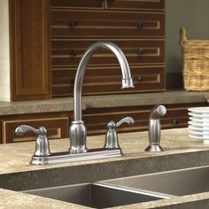 Bring a sense of style and comfort to your home with the Moen® Traditional Two-Handle Kitchen Faucet. Along with its additional side sprayer, this faucet has an aerated flow that's ideal for everyday kitchen cleanup. Available in a Spot Resist® Stainless Finish, this faucet is impervious to fingerprints and water spots, so your kitchen will stay cleaner longer.