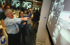 On the day of Opportunity's landing -- 202 days after launch -- Pete Theisinger, Project Manager, and Jennifer Trosper, Spirit Mission Manager for Surface Operations react as the first images arrive from the NASA Mars Rover Opportunity. (Bill Ingalls/AFP/Getty Images)