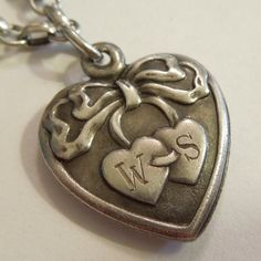 Sterling Silver Puffy Heart Charm - Two Hearts Tied in a Bow - Engraved 'W' and… Heart In Nature, Heart Art, Love Heart, Locket Charms, Heart Locket, Charm Tattoo, Hanover Street, Metal Embossing, Ladies Jewelry