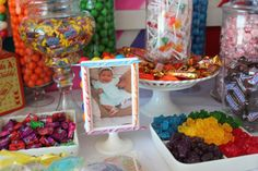 Put pictures of her each month in candy decorated frames around the tables!