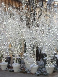 curly willow, lights, white balls, white snow flakes, glittery white decorations, white terra cotta pots
