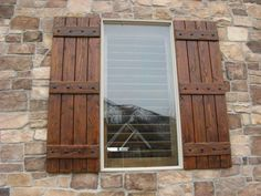 tan brick house with dark woodstained shutters - Google Search