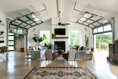 The best thing about the living room is the over-head garage doors that open wide.