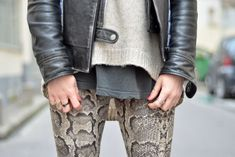 Layers : printed skinnies, comfy sweater, and leather jacket - if you are stick straight you can wear any length top with skinnies - if you have a larger behind & hips - these layered lengths will look particularly chic and polished - a high low sweater and a bit of tee showing - not too much bulk for a sleek vertical look.
