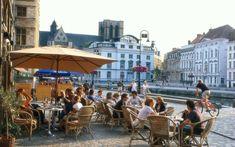 Amsterdam to Gent. People in street cafes, Graslei, Gent, Flanders, Belgium, Europe