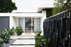 This Modern Home situated in a residential area of Melbourne was inspired by the architectural aesthetics of mid-century homes of Palm Springs, and at the same Mid Century House, House Exterior, Modern Outdoor Spaces, Inspired Homes, House Design, Spring Inspiration, Mid Century, Modern Landscaping, Palm Springs