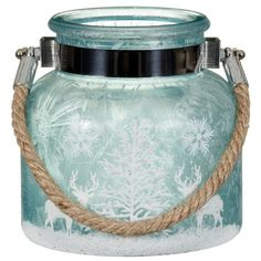 "Ice blue frosted candle jar with deer & tree. ""Frosted Candle Jar with Rope Handle"". Product Code: 312913. 2.99£ (~$4.00). Sold by bmstores.co.uk. Keep your home smelling festively themed with these gorgeous scented candles. 3 Christmas designs available: Ice Blue, White, & Red."