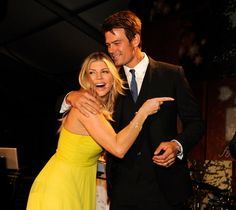 Fergie and Josh are Expecting — See Their Sweetest Moments!: Fergie and Josh Duhamel shared a laugh at the fifth annual Cadillac Super Bowl Grand Prix in Miami in February 2007.  : Josh Duhamel held out an umbrella for wife Fergie at the Golden Globe Awards in January 2010.  : Fergie and Josh Duhamel cuddled up at the May 2011 FiFi Awards in NYC.