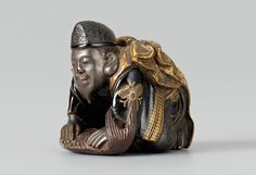 A wood and maki-e lacquer netsuke of Ebisu with a sea bream. Late 19th century - Kunsthaus Lempertz