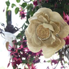 Definitely a big shoulder flower! Yep. I have to make this. Button and twine center.