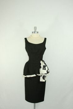 1950's Dress - Vintage Classic Black and White Sleeveless Peplum Wiggle Cocktail Party Frock. $180.00, via Etsy.
