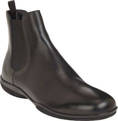 $780, Black Leather Chelsea Boots: Prada Round Toe Chelsea Boot Black. Sold by Barneys New York. Click for more info: https://lookastic.com/men/shop_items/288971/redirect