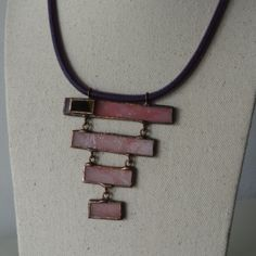 'Collana Barre', is a necklace made out of pink frosted glass  and a small black inlaid rectangular iridescent glass The collar is made of 'caucciu' rubber. Unique piece, handmade in Italy by Anni Luce di Convalle.
