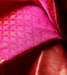 "A Kanjeevaram saree is a must have in every Indian woman's closet. Kanchipuram is a town in Tamil Nadu. The town has a fabulous weaving past. The silk base of the Kanjeevaram is thicker than any other silk saree and this thickness makes it the most expensive silk sarees in India. It is believed that ""The heavier is the silk, the better is the quality"". The most common motifs found in Kanjeevaram sarees are the peacock and parrot. #MyStateWithJaypore"